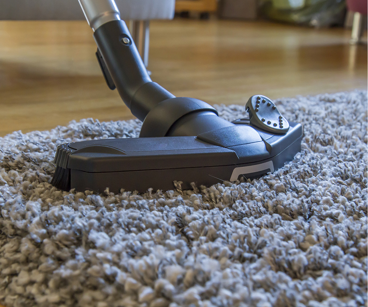 Vacuum cleaning a carpet